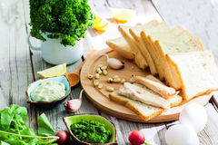 Foodstuffs for sandwiches. Top view foodstuffs for sandwiches on wooden background Royalty Free Stock Image