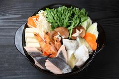 Foodstuffs of Seafood Hot Pot. On dark background stock images