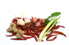 Foodstuffs. On white including peppers, chilli, garlic,Lemon grass and onion Stock Photo