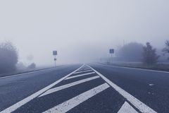 foogy sunrise at highway Stock Photos