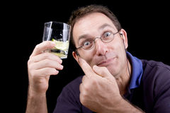 Fool man holding and showing of him gin drink. With lime, isolated on black Royalty Free Stock Photography
