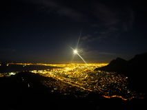 Fool Moon Hiking. During a fool moon hiking which occured on the Lion's head in Cape Town South Africa. While the sun was seting, the full moon was pointing at Stock Photography