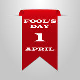 Fool`s Day on 1 April. Red ribbon on a gray background Stock Image