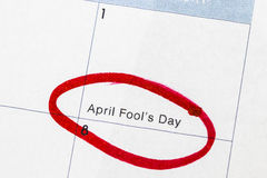 `Fool`s day` is a text written on the calendar, circled in red marker.  stock photography