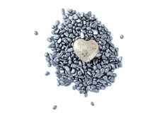 Fool's gold heart on hematite beads. Fool's gold (pyrite) heart on hematite small pebbles isolated on white background Royalty Free Stock Images