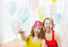 Fooling around girl showing tongue Royalty Free Stock Photography