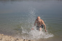 Fooling around in the water, having fun and sprinkles Stock Photos