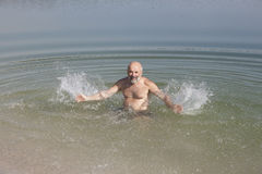 Fooling around in the water, having fun and sprinkles Stock Photography
