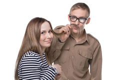Fooling around woman and man making moustache Stock Images