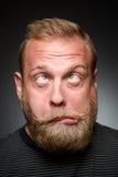 Fooling bearded man Stock Photography