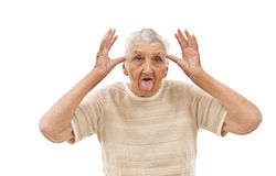 Foolish grandma. Very old woman behaving like a  child on an isolated background Stock Photos