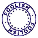 Grunge Textured FOOLISH Round Stamp Seal. FOOLISH stamp seal watermark with grunge texture. Designed with round shapes and stars. Blue vector rubber print of royalty free illustration