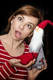 Foolish young woman posing with Santa Claus, Christmas scene Royalty Free Stock Image