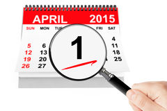 Fools' Day Concept. 1 april 2015 calendar with magnifier on a white background Royalty Free Stock Photos