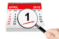 Fools` Day Concept. 1 april 2018 calendar with magnifier. On a white background Stock Image