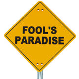 Fools paradise. Words fools paradise on a roadsign against white background, concept of Royalty Free Stock Image