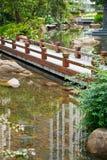 Foootbridge in garden Royalty Free Stock Images