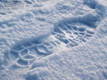 Footprint in the snow. Footprint in the fresh snow stock image