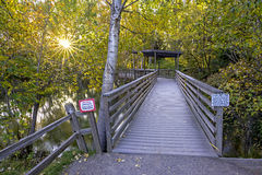 Foor path bridge with warning signs on it Stock Image