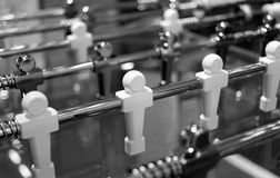 Foosball. Metal players are ready to play Stock Photo