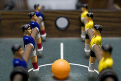 Foosball battle close up. Photo of entertaining foosball game table Royalty Free Stock Image