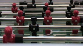 Table soccer. Foosball. Female hand lays a white ball on the center of the field of a board game in football. Close-up. Foosball. Female hand lays a white ball stock video