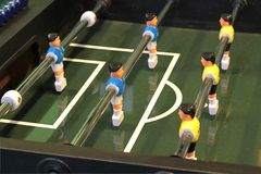 Foosball. Foosball, Table football game or Table Soccer with yellow and blue players Royalty Free Stock Photos