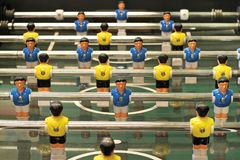 Foosball. Foosball, Table football game or Table Soccer with yellow and blue players Royalty Free Stock Photo