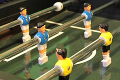 Foosball. Foosball, Table football game or Table Soccer with yellow and blue players Royalty Free Stock Photography