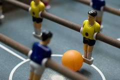 Foosball game close up diagonal. Photo of entertaining foosball game table Royalty Free Stock Image