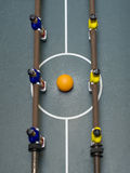 Foosball game top shot. Photo of entertaining foosball game table Royalty Free Stock Images