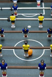 Foosball game vertical format. Photo of entertaining foosball game table Stock Photography