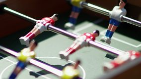 Foosball. Invisible playing table football. Unknown playing foosball. Table soccer. Foosball. Invisible playing table football. Unknown playing foosball. The stock footage