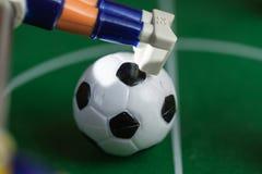 Foosball. Plastic toy soccer ball foosball Stock Image