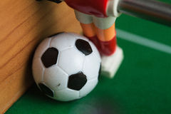 Foosball. Plastic toy soccer ball foosball royalty free stock photography