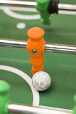 Foosball player with ball Stock Image