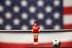 Foosball player table soccer stock image