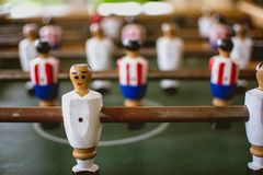 Foosball players in foosball game stock photo