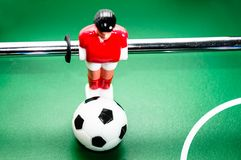 Foosball. Red player, entertainment arcade soccer Royalty Free Stock Photography