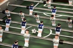 Foosball tabell eller tabellfotboll och spelare Fotografering för Bildbyråer
