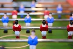 Foosball table closeup Stock Images