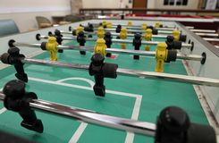 Foosball table with figurines for playing games stock images