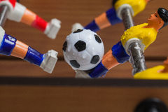 Foosball. Table football game with a ball stock images