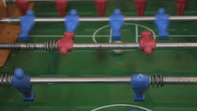 Foosball. Table game in action stock video footage