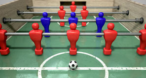 Foosball Table. At ground level with a soccer ball in front of the red team ready to kick off a soccer match stock photos