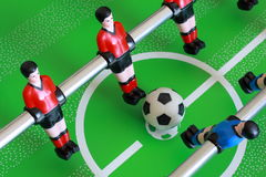 Foosball table match. Kick off on a foosball table Royalty Free Stock Images