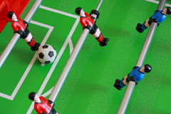Foosball table match. Kick off on a foosball table Stock Photo