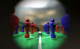 Foosball Table Through A Peephole. A view of a foosball team through a peephole in the side of the game showing them ready for kickoff Stock Photo