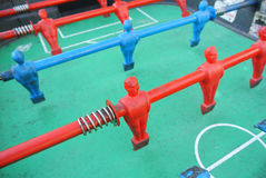 Foosball table player Stock Image