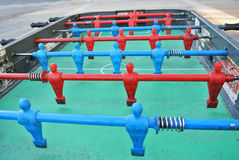 Foosball table player Royalty Free Stock Image